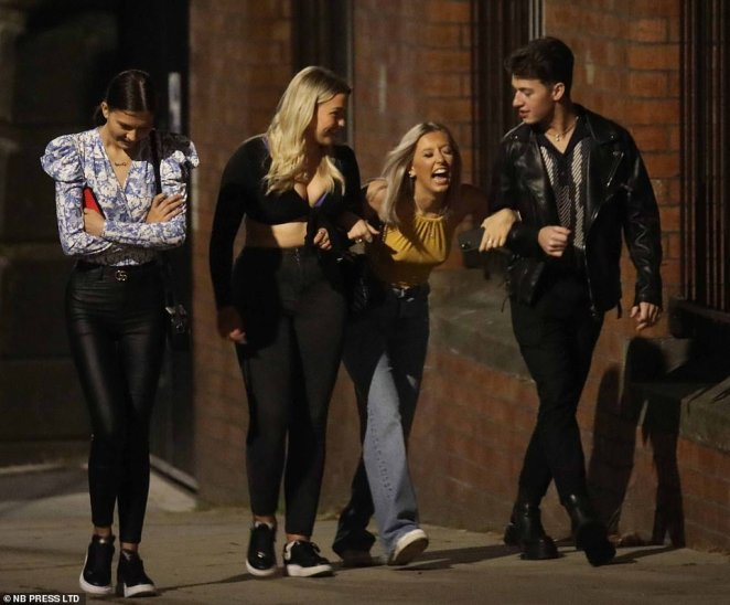A group of revellers hit the streets of Leeds without masks and enjoy a night out just days before the 10pm curfew on pubs, bars and restaurants comes into place