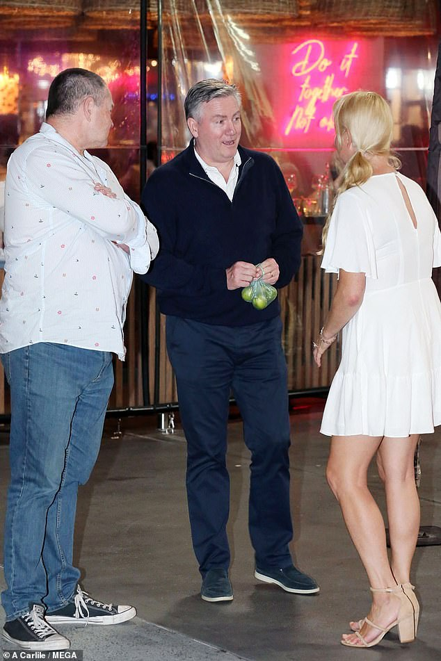 Fancy seeing you here! Eddie was seen laughing and joking with lucky fans including a festively-dressed blonde woman