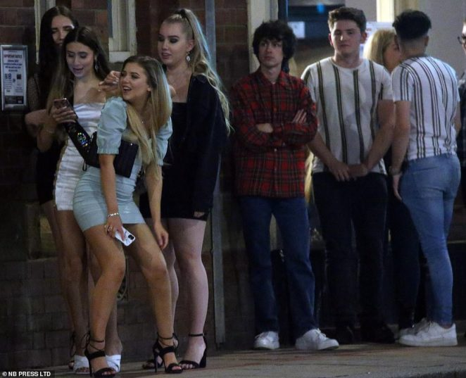 Party-goers gather on the streets in Leeds to enjoy a night out and party into the small hours just days before the new curfew is kicked into force