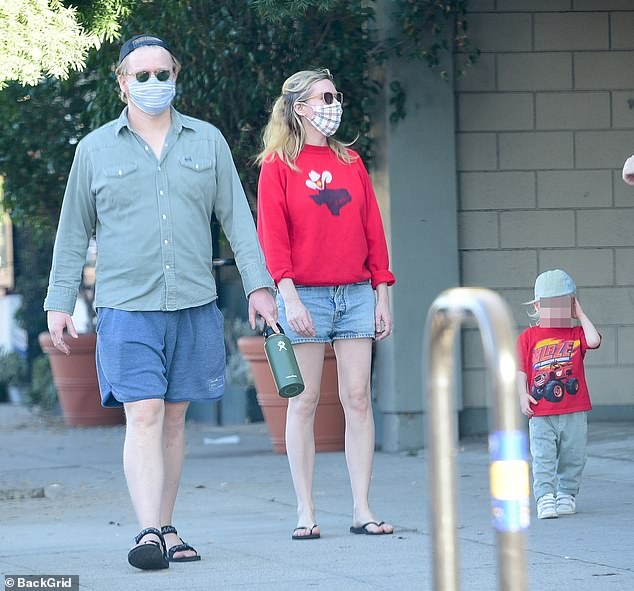 Protective parents:Jesse and Kirsten, who each donned a cloth face mask, walked side-by-side as they kept a watchful eye on their little one