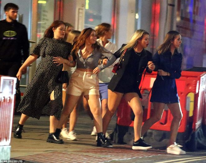 Groups of students gathered on the streets of Leeds last night to enjoy the start of the academic year, before 10pm curfews come into effect