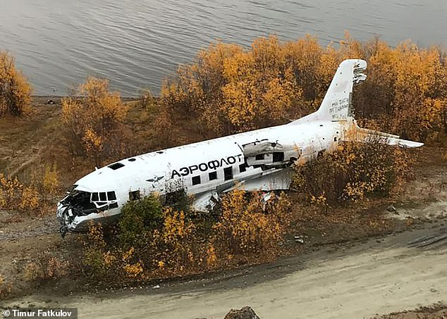 Another plane among the many discarded in the Siberian town was a Il-14 which is now lying by a lake