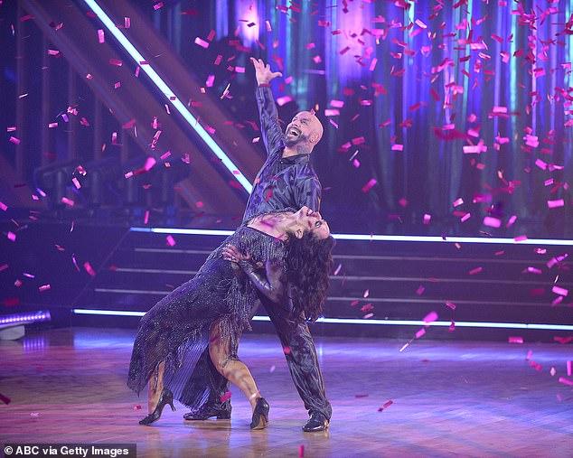 Foxtrot dance:Backstreet Boys singer AJ McLean, 42, and partner Cheryl Burke, 36, swept the floor with their foxtrot to Dean Martin's Ain't That A Kick In The Head