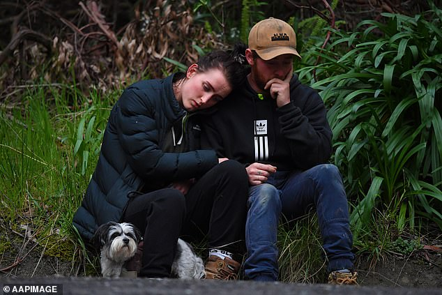 Friends console each other at the scene after police confirmed William's body had been found