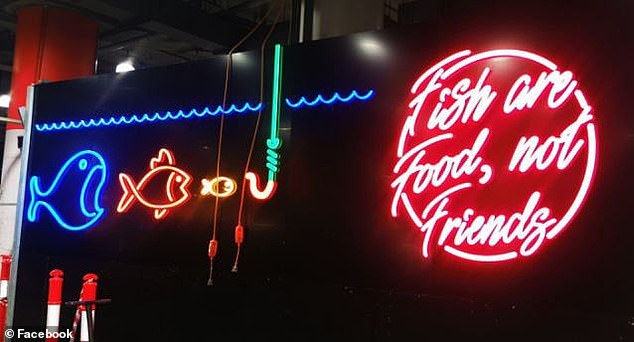 Vegans slammed Sydney's Paddington Markets after a sign saying 'fish are food, not friends' was pictured inside the building and posted online (pictured)