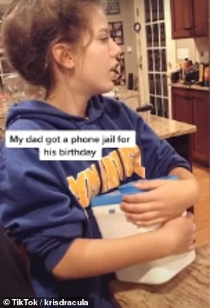 A hilarious video of a teenager in the US captures her mixed reaction her brother locks her phone inside a smartphone 'jail' for 40 minutes