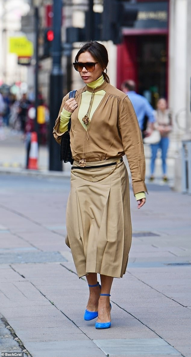 Special Attention: However, the star decided to turn things around by leaving Wolsley Restaurant in a ruched khaki top, yellow polo neck and a low pleated midi skirt.