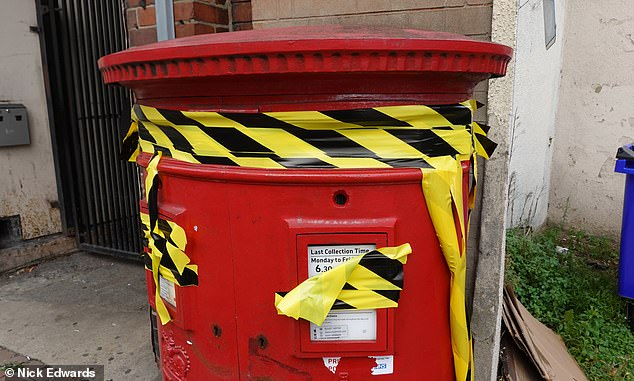 Today tape was wrapped around the post box on Balham High Street after parcels and letters were left in a state of limbo