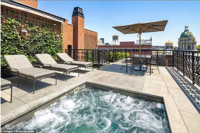 The loft has six terraces, one of which has a hot tub and a view over SoHo