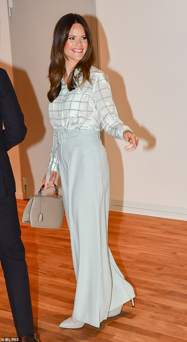 Sofia, 35, donned a monochrome chiffon blouse, paired with a pair of mint green paper-bag tailored trousers and a chunky matching belt