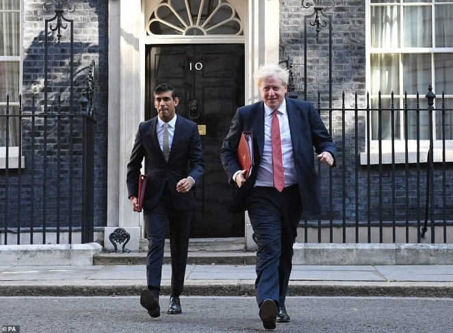 Chancellor of the Exchequer Rishi Sunak (left) and Prime Minister Boris Johnson leave 10 Downing Street, for a Cabinet meeting to be held at the Foreign and Commonwealth Office (FCO) in London, ahead of MPs returning to Westminster after the summer recess on September 1.The Chancellor last night cancelled plans for a full-scale Budget in November