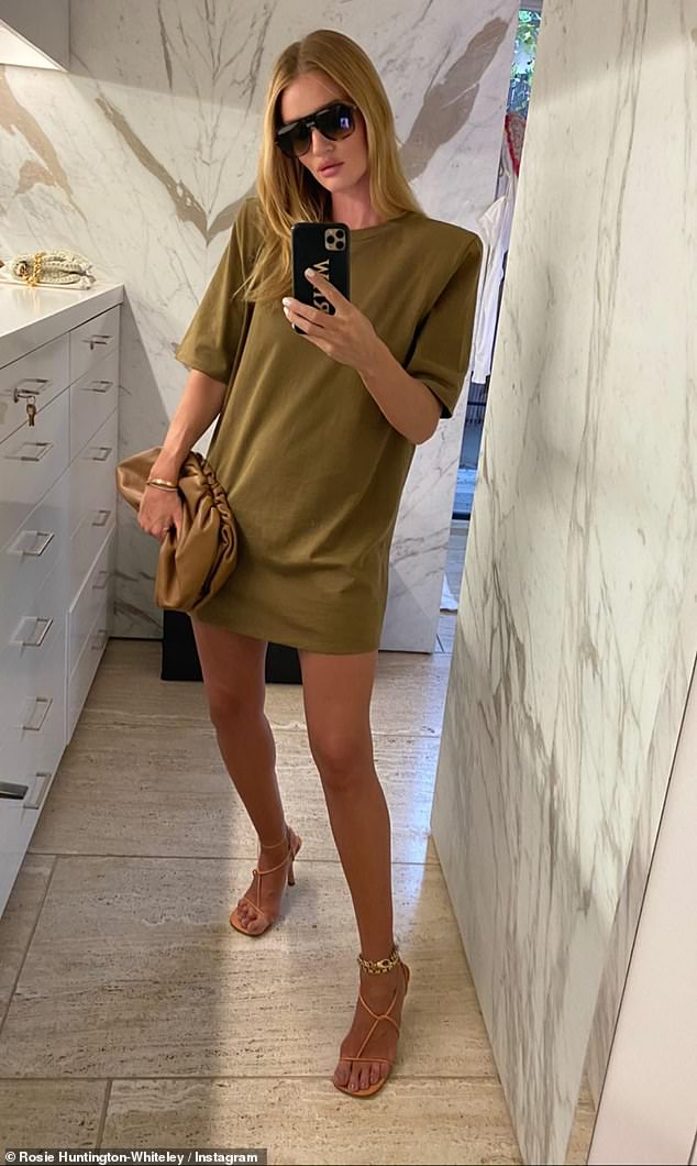 Leggy display: The sizzling snaps come after Rosie posted a selection of stunning fashion snaps to Instagram, including one outfit of her modelling a£1,130 Pouch gathered leather clutch and The Leather BV Line Sandals 90 which cost £685fromBottega Veneta