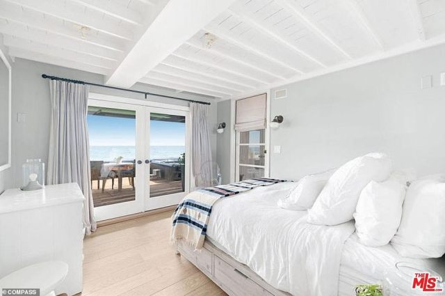 Sweet dreams: The main bedroom has French doors that open onto a wooden deck