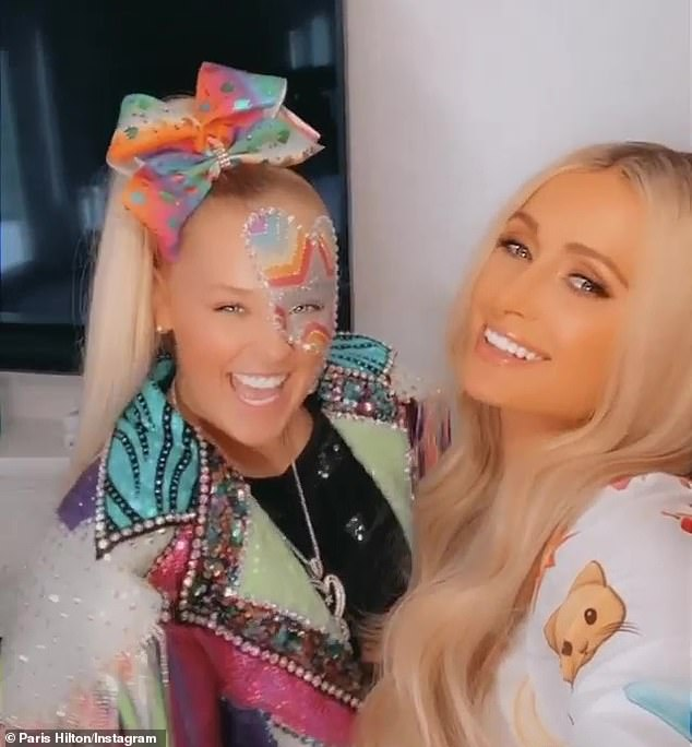 'Look who just got here?' The Simple Life alum Paris Hilton (R) invited Dance Moms alum JoJo Siwa (L) to her 'Slivington Manor' in Beverly Hills on Wednesday
