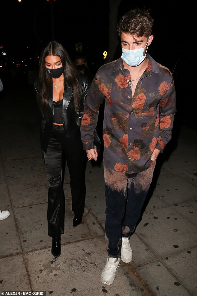 Masked up: Both Chantel and Andrew, who confirmed their couple status in July, wore masks to the socially-distanced event