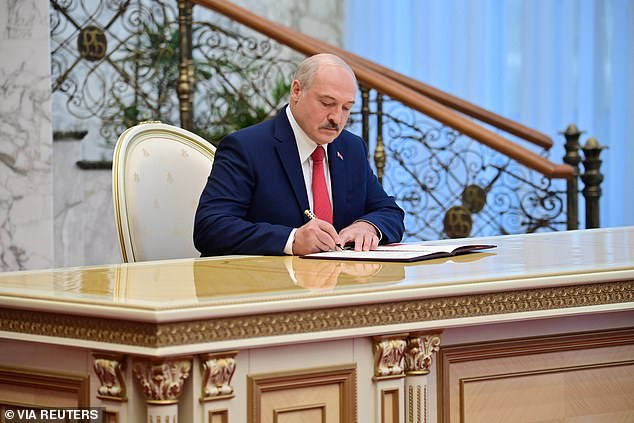 Lukashenko, who has been in power since 1994 and will now begin his sixth term (pictured at today's inauguration), claimed a landslide victory with the opposition accusing him of massive vote-rigging