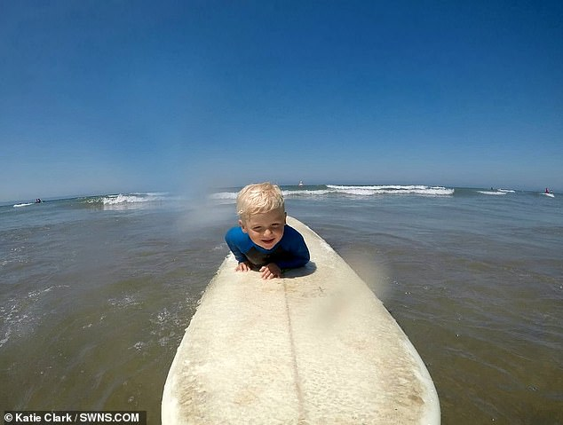 Nate needs help from his father, Lee, to paddle out because of the size of the surfboard but when he spots a wave he can take it on himself