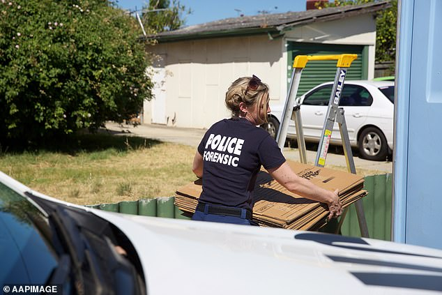 Police search a house at Kewdale that is connected to the historic Claremont killings in Perth on December 23, 2016