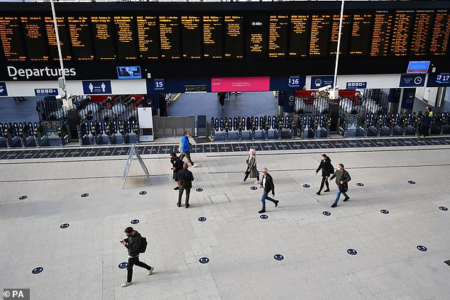 A small number of commuters at Waterloo Station, in London in the middle of what should be rush hour on Thursday, after the PMannounced a range of new restrictions to combat the rise in coronavirus cases in England