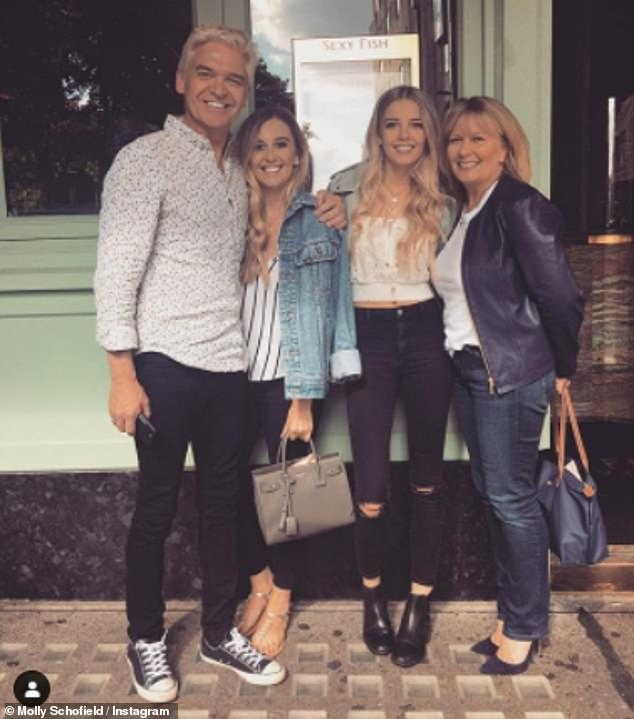 Family:Phillip credited his wife, Stephanie Lowe, 56, and daughters Molly, 27, and Ruby, 24, for supporting him (pictured together in 2017)