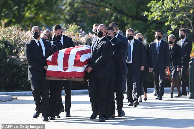Ruth Bader Ginsburg's flag draped coffin arrives at the Supreme Court to lie in repose for two days after she died from complications from colon cancer on Friday