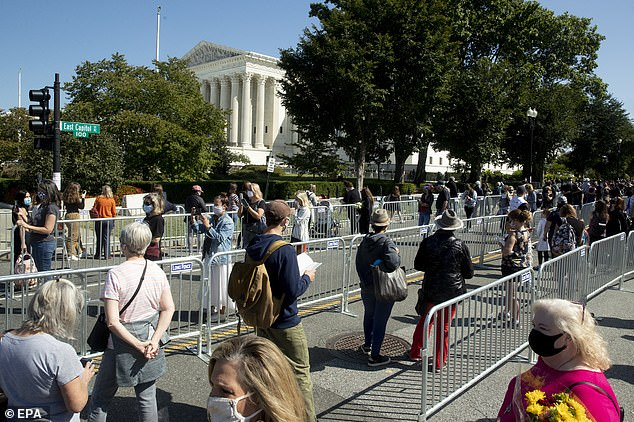 People line up in socially distanced rows to wait their turn to pay their respects to Ruth Bader Ginsburg