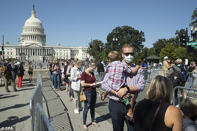 Mourners, many of whom brought their children, wait in line to pay their respects to Ginsburg