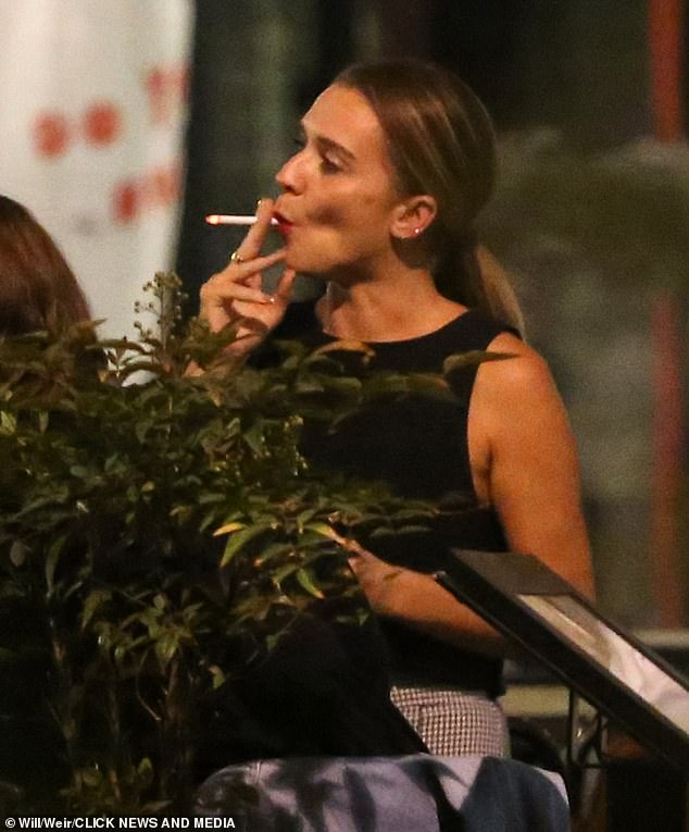 Letting her hair down!The baker, who won the 2016 series, appeared in very high spirits as she enjoyed drinks at a bar in London following her split from estranged husband Liam Macaulay