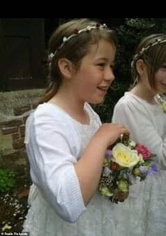 Aged just 11, Rosie had a ten-hour operation to remove the tumour and then had chemotherapy and radiotherapy to give the best chance of the cancer not returning. Pictured, Rosie at a wedding shortly before her first diagnosis