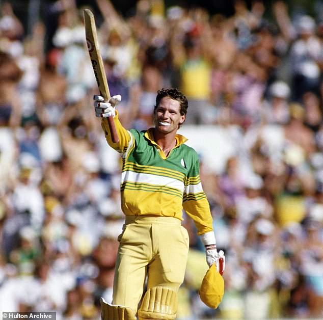 Jones pictured raising his bat in celebration of reaching a ton in a ODI against Pakistan in 1987