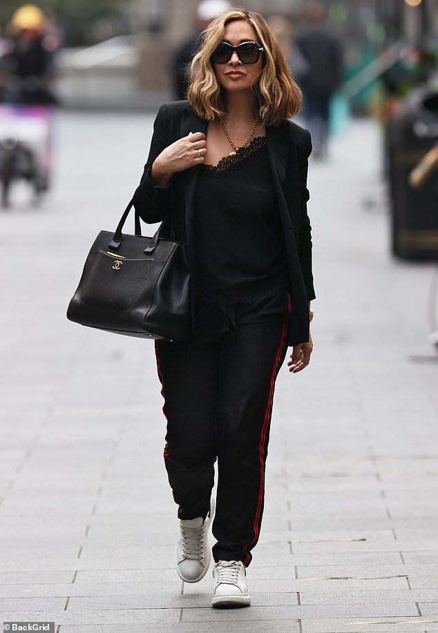 Low-key:Myleene displayed her classy fashion sense by opting for the simple black lace camisole with a matching blazer as she strolled into the radio studios