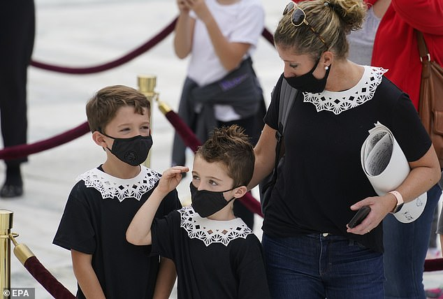 A mother dressed her kids up in a makeshift version of Justice Ruth Bader Ginsburg's signature collar to pay their respects to the late judge outside the Supreme Court