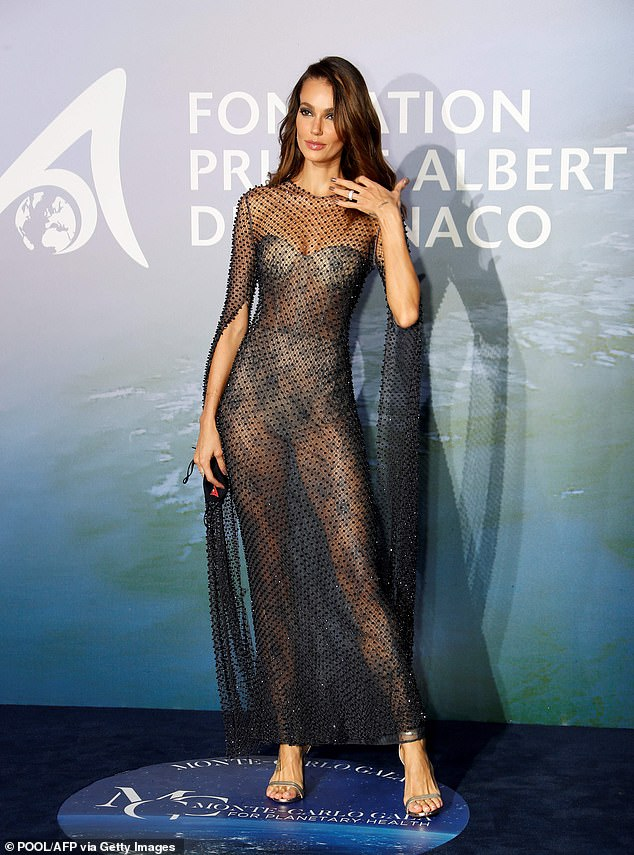 Dramatic: The mesh one-piece was hard to miss as Sofia highlighted her amazing physique on the blue carpet
