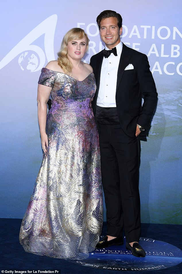 Perfect pair: Rebel Wilson and her boyfriend Jacob Busch made their red carpet debut on Wednesday, as she graced her first red carpet since shedding more than 40 pounds