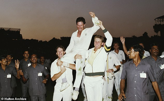 Australia captain Allan Border (centre) is hoisted high by team mates Dean Jones (left) and Tom Moody (right) after Australia won the 1987 World Cup Final in Calcutta