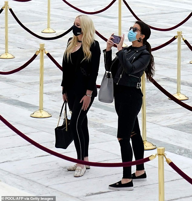 Paying respects: Tiffany's companion took a picture while they stood in front of the empty line