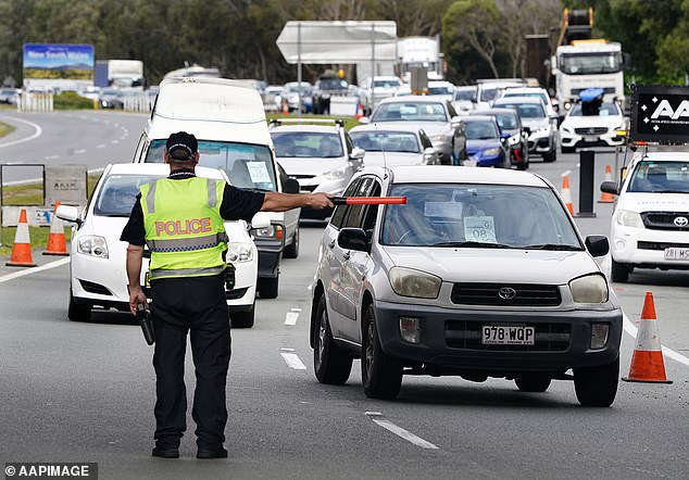 Premier Annastacia Palaszczuk said on Wednesday: 'We would like to see continued support on our borders.' Pictured: A police road block