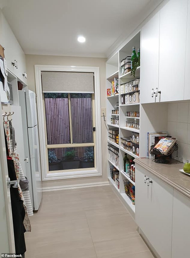 The open pantry sits opposite the fridge in the kitchen and the organised style makes it easier to see how much food is remaining