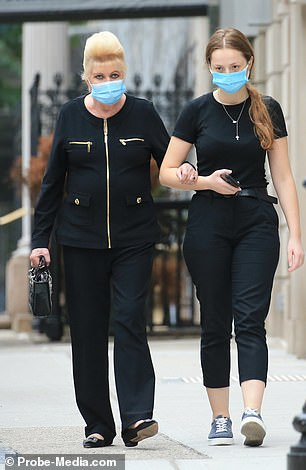 Ivana and her companion both wore disposable face masks for the walk back to the US President's ex-wife's abode