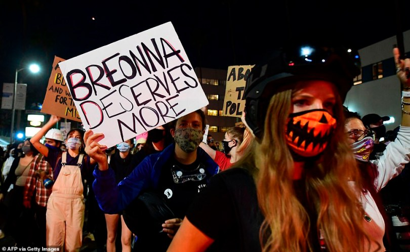 Demonstrators protesting the lack of criminal charges in the killing of Breonna Taylor by the Louisville Metropolitan Police Department, march along Sunset Boulevard in Hollywood, California last night on the second night of protests