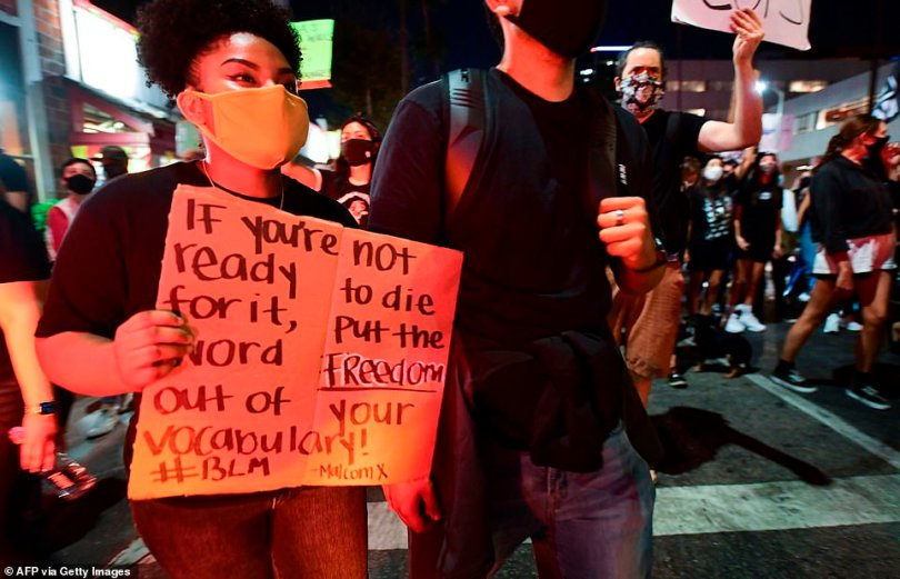 Demonstrators protesting the lack of criminal charges in the killing of Breonna Taylor by the Louisville Metropolitan Police Department, march along Sunset Boulevard in Hollywood, California last night