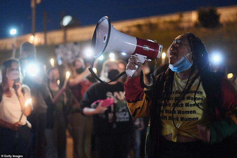 Actvist Ohun Ashe leads chants with protestors during a protest action on Interstate 64 last night in St Louis, Missouri