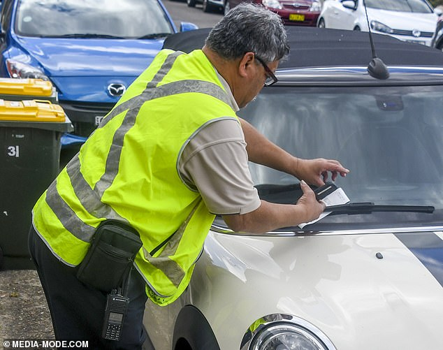 Just doing his job: An inspector placed the ticket to the windshield wiper of her Mini Cooper, parked near her Sydney home