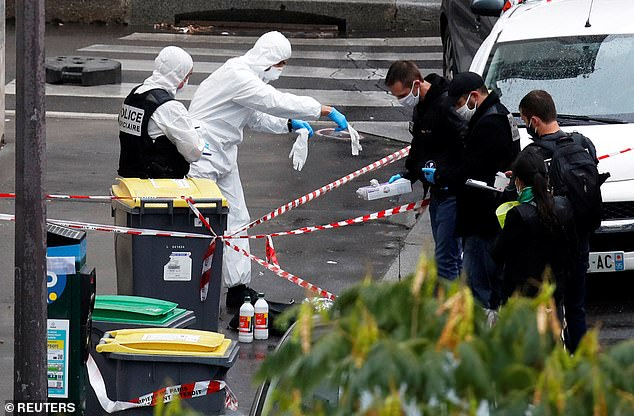 Forensic experts work at the scene after the rampage which has left two in a criticial condition