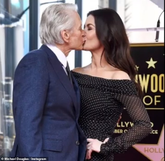 Intimate moment: In another shot shared by Michael, the couple kiss during an appearance on the Hollywood Walk Of Fame