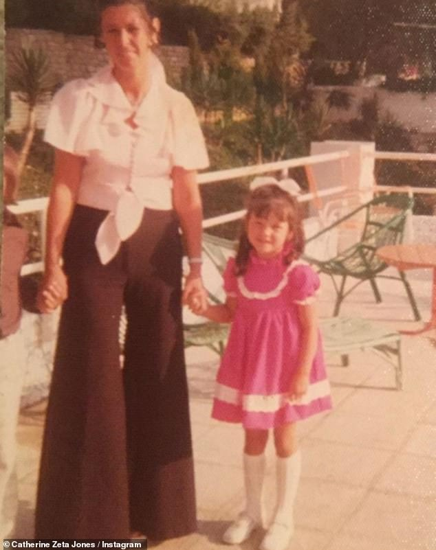 Old times: Meanwhile, Catherine referred to her birthday by sharing an old photo of herself and her Irish mother Patricia, taken during a bygone childhood vacation