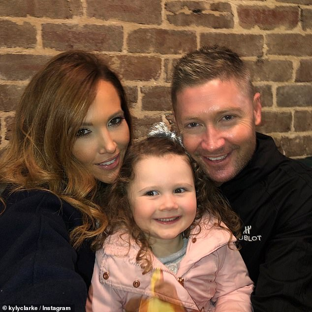 Co-parents: Michael separated from wife Kyly, 39, in September last year, but only revealed their split in a surprise announcement on February 12. Pictured Kyly and Michael with their daughter last yearKelsey Lee
