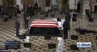 RBG's personal trainer performs push-ups in front of her casket