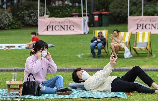 The low number of cases prompted health authorities to ease a number of restrictions in the state (pictured, Sydney residents enjoy a day out at the park)