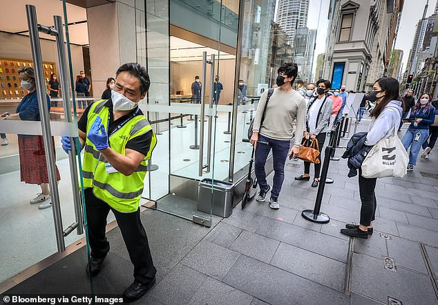 The state's three-day streak of no new locally acquired infections ended on Friday, with a man in his 50s from Sydney's southwest testing positive (pictured, shoppers line up at the Sydney Apple Store)